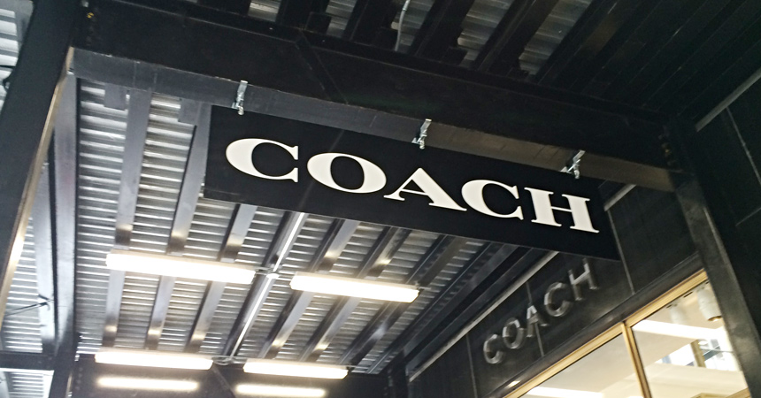 Coach Sidewalk Bridge Sign